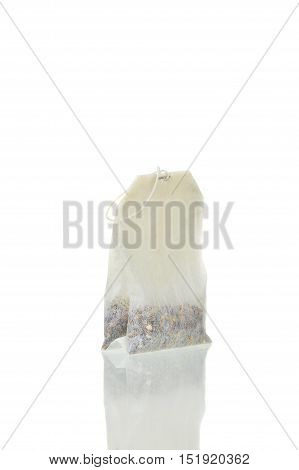 Closeup Of A Teabag Isolated Over White Background