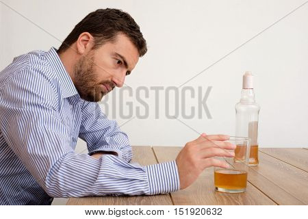 Depressed Man Abusing Of Alcohol Trying To Forget His Problems