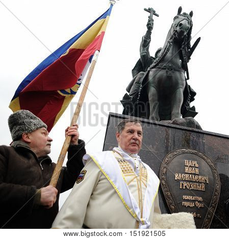 Orel Russia - October 14 2016: Ivan the Terrible monument opening ceremony. Monument and people with banners infront the monument