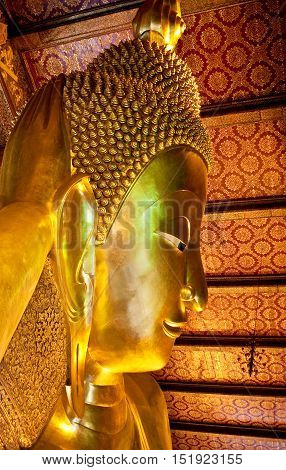 BANGKOK, THAILAND - JANUARY 28, 2011: Statue of Reclining Buddha in Wat Pho Temple. The image of reclining Buddha is 15 m high and 43 m long.