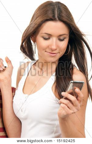 Woman Holding Cell Phone And Shopping Bags In Hand