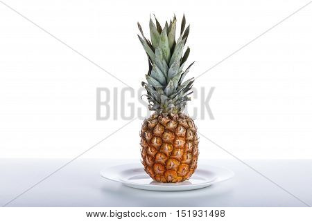 Ripe Pineapple On A White Wooden Table.pineapple Ripe