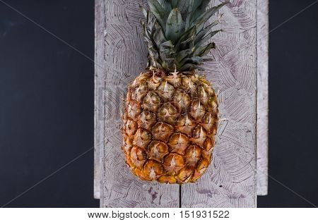 Pineapple On The Wood Texture Background. Pineapple Ripe.