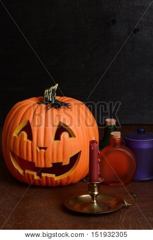 halloween still life with candle and pumpkin