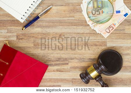 Wooden Law Gavel with legal book, money and pc keyboard