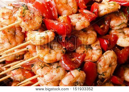 prawns with red pepper on skewers. background