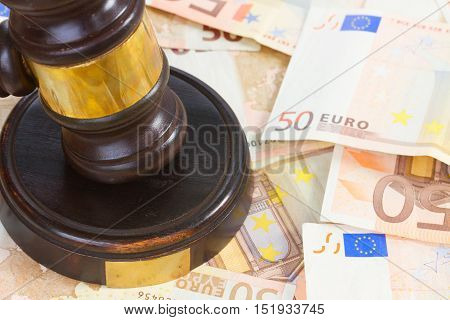 Wooden Law Gavel and Euro Money close up