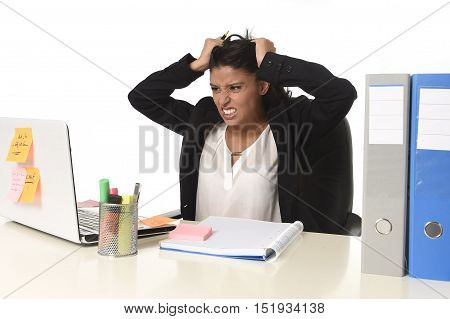 young beautiful latin businesswoman suffering stress working at office computer desk looking worried and desperate having problem pulling her hair at work in overwork concept