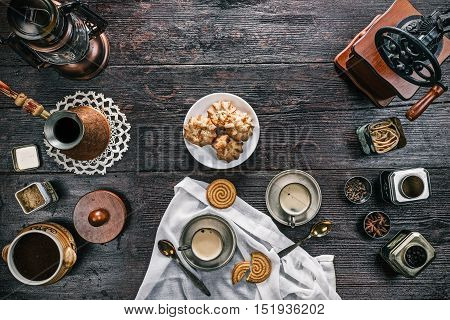 Metal vintage cups of coffee with cheese cookies on the wooden table. Flat lay