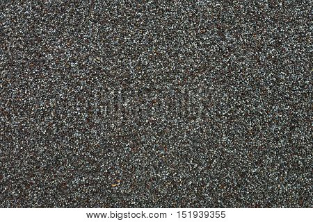 Dry gray poppy seeds texture pattern food background