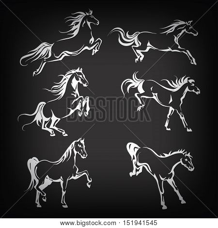 Vector set with hand-drawing graphic of a running horses on blackboard for design