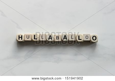 HULLABALLOO printed on white dice over head view
