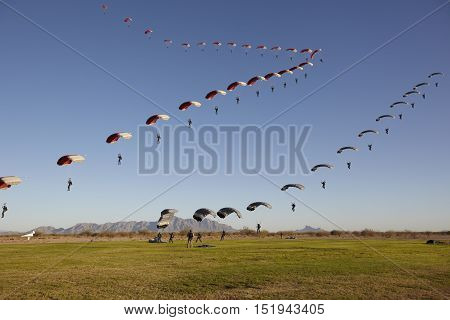 Compilation of Skydivers approaching for landing showing landing path