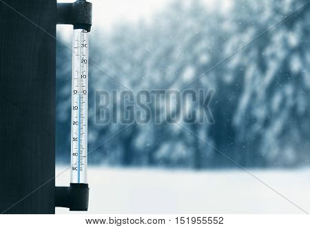 Meteorology, Forecasting And Winter Weather Season Concept - Thermometer On A Glass Window With Blur