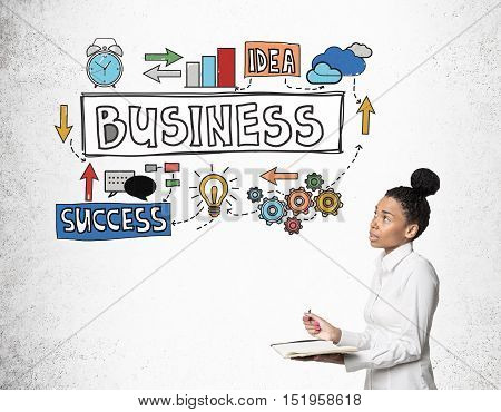 African Girl With Notebook With Business Sketches