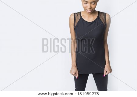 Close up of shy African American girl standing against white wall and looking at the viewer. Mockup