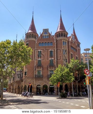 BARCELONA SPAIN - JULY 5 2016: Casa de les Punxes (Casa Terrades) on Avinguda Diagonal street. The building in modernism style was built 1902-1905 and designed by Josep Puig i Cadafalch