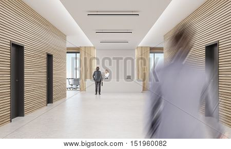 Rear view of businessman talking to blond secretary behind reception desk while his colleague is rushing to meet him. 3d rendering. Mock up