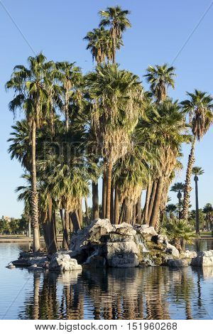 Palm Island of rocks and bouldrs in the middle of Encanto park lake Phoenix downtown Arizona
