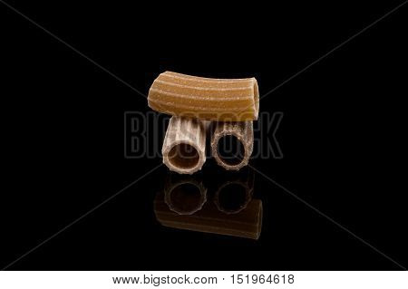 Close-up Of Pasta Over Black Background