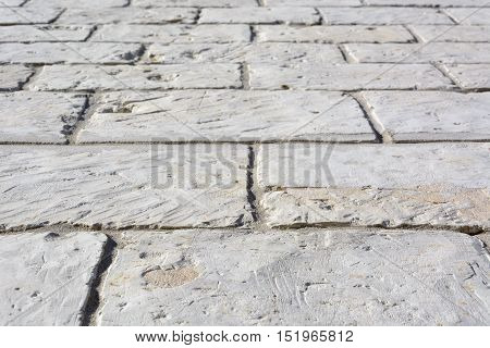 Limestone light gray cobbled street for texture or background