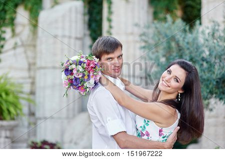 young couple walking and hugging in the park.