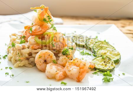 Shrimp and risotto on a white plate