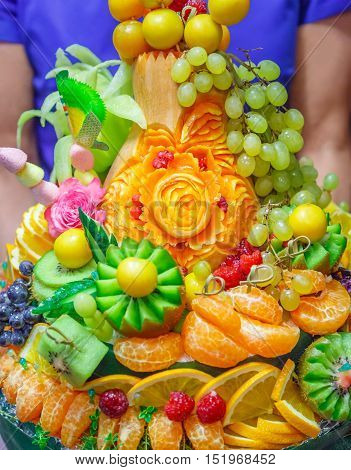 Collection of fruits beautifully decorated in the basket