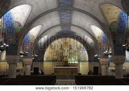 Lisieux France - September 7 2016: Inside the Basilica of Saint Therese of Lisieux in Normandy. The crypt chapel lower richly ornamented