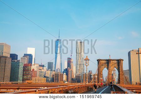 NEW YORK CITY - SEPTEMBER 3: Brooklyn bridge with people on September 3 2015 in New York City. It's a bridge in New York City and is one of the oldest suspension bridges in the US.