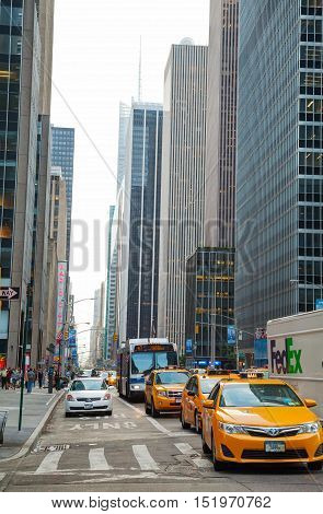 NEW YORK CITY - SEPTEMBER 5: Yellow cabs at Times square in the morning on October 5 2015 in New York City. It's major commercial intersection and neighborhood in Midtown Manhattan at the junction of Broadway and 7th Avenue.