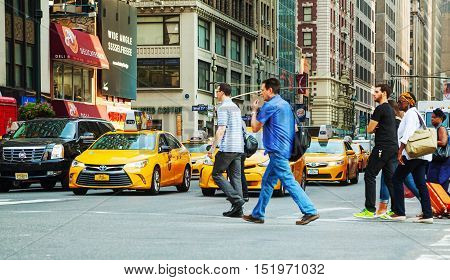 NEW YORK CITY - SEPTEMBER 04: Yellow cabs with people in the morning on September 4 2015 in New York City.