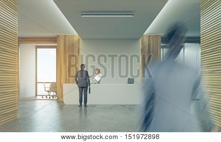 Rear view of two businessmen. One is entering the floor. The second is talking to blond secretary on reception. 3d rendering. Mock up. Toned image