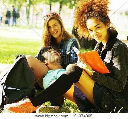 cute group teenages at the building of university with books huggings, diversity nations, having lunch