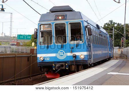 Stocksund, Sweden - July 28, 2016: A blue commuter train on the SL Roslagsbanan railroad line number 29 at the Stocksund station.
