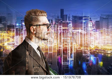 Side view of young businessman in glasses standing against large cityscape at night. Double exposure. Toned image