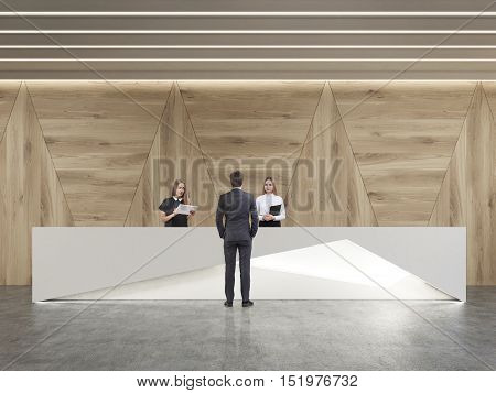 Rear view of man talking to receptionists in room with wooden walls and concrete floor. Concept of business communication. 3d rendering.