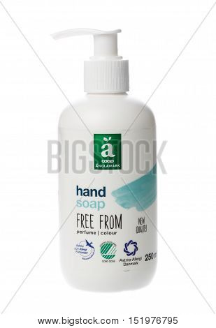 Stockholm, Sweden - April 30, 2016: A white bottle withdispenser contains 250 ml Coop Anglamark soap for the Swedish market isolated on white background.