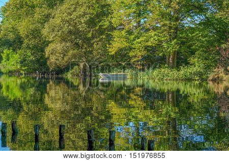 Beautiful reflections in the lake on a sunny October morning in Kent, England