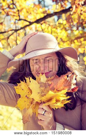 Woman In Autumn Park.