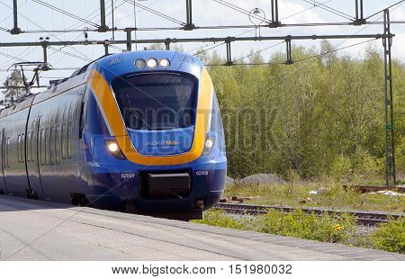 Jarpen, Sweden - May 30, 2016: Passenger train type X62 inservice for Norrtag arriving at the Jarpen railway station.