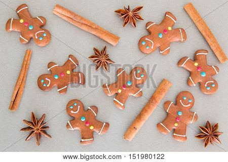 Many gingerbread men on a grey board for Christmas