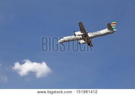 Stockholm, Sweden - May 3, 2016: One SAAB 2000 (SE-LTV) airliner in service for BRA (Braathens Regional Airlines) approaching Stockholm Bromma airport against blue sky with a white cloud.