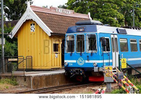 Djursholm, Sweden - July 15, 2016: A blue Stockholm public transport train has stoped at the Vendevagen station at the suburban rail network Roslagsbanan.