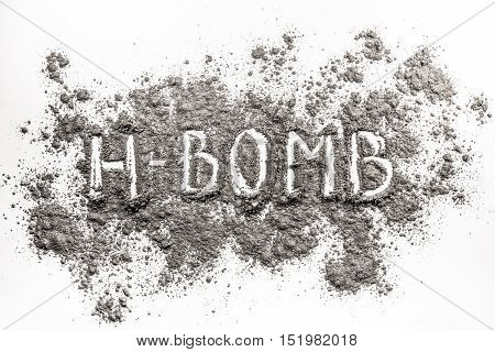 Atomic hydrogen bomb word as war weapon concept written in ash dust dirt