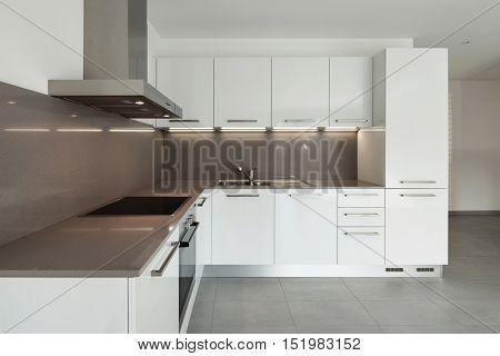Interior of empty apartment, domestic kitchen, tiled floor