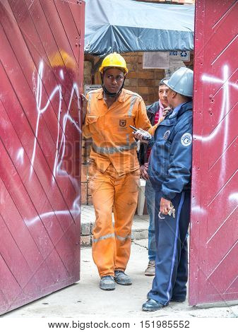 Bogota Colombia - April 30 2016: Construction workers standing at the gate of the renovated building