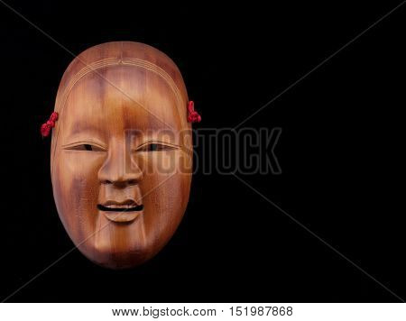theater mask made in wood varnished free space for text