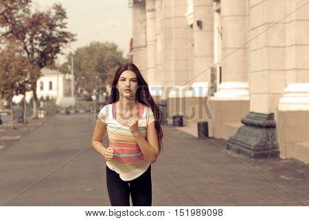 Girl Runs Along The Sidewalk.