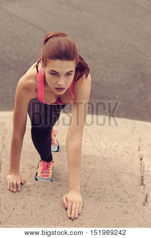 Girl Doing Stretching On The Steps